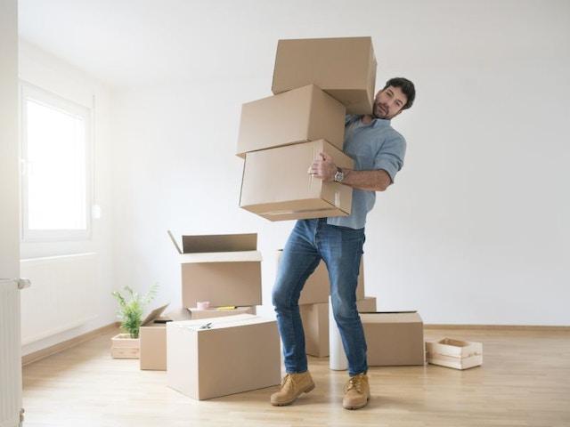 Verhuizen dozen huren man