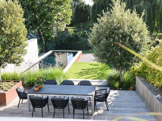 Vlaamse tuinaannemer tuin helling vijver