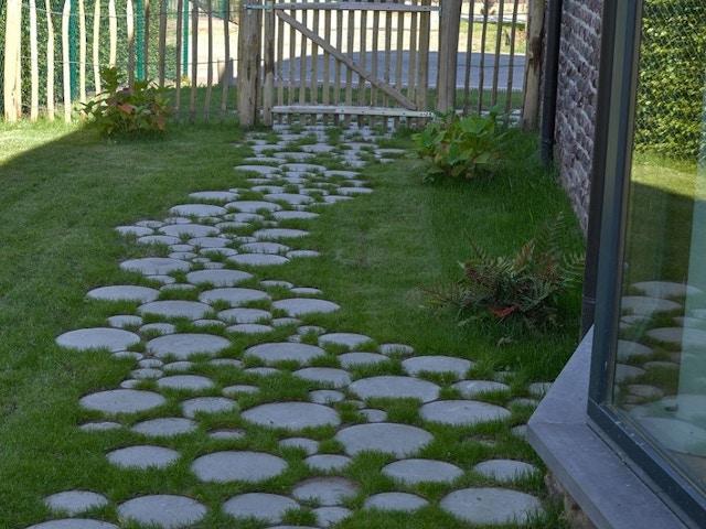 tuinpad waterdoorlaatbaar waterpasserend tegels